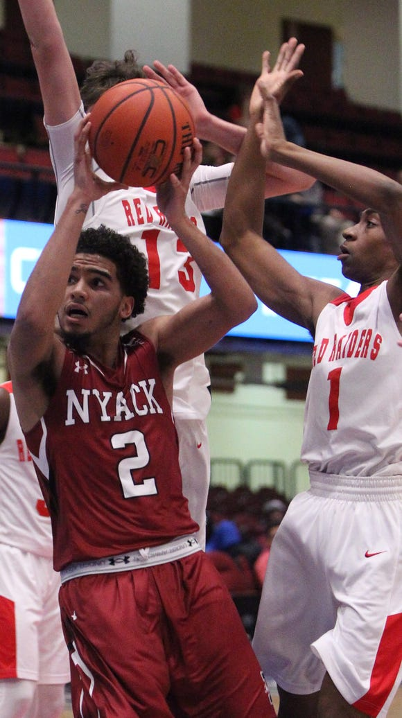 Nyack's Justin Rodriguez drives to the net during a
