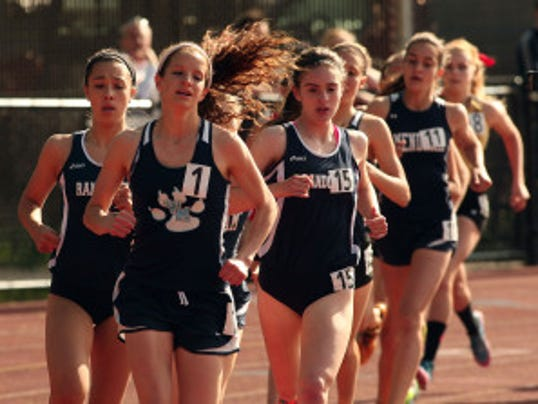 West Morris senior Kylene Cochrane, c, leads Randolph's Liz Wellman, l, and  Nora May McSorley during the 1,600 meters at the Morris County Championships.  Photo by Bob Karp/Daily Record