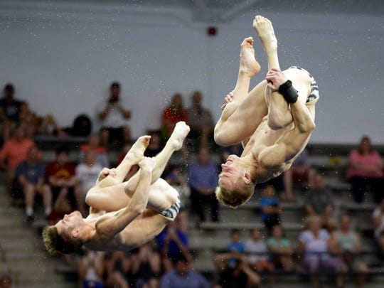 Steele Johnson, right, and David Boudia dive in the synchronized men's 10-meter platform final at the U.S. Olympic diving trials Thursday, June 23, 2016, in Indianapolis. The pair won the competition. (AP Photo/AJ Mast)