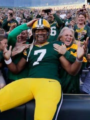 Green Bay Packers quarterback Brett Hundley takes a Lambeau Leap after rushing for a touchdown against the Los Angeles Rams on August 31.
