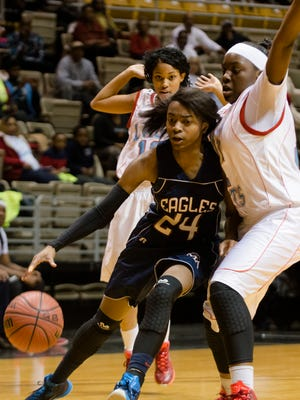 Montgomery Academy's Jade Brooks (24) drives on Midfield's Jemeriah Moore (22) during the AHSAA Class 3A Central Regional Championship on Thursday, Feb. 19, 2015, at the Dunn-Oliver Acadome in Montgomery, Ala.