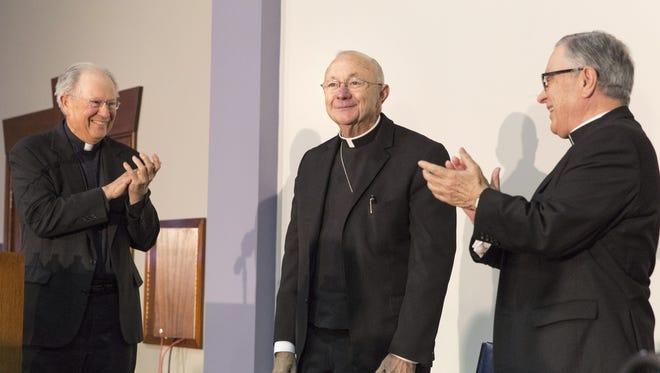 Former Bishop Michael Jarrell, right, and Bishop J. Douglas Deshotel during a press conference.