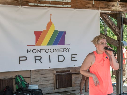 Saylor Alexander of Birmingham sings during Montgomery Pride Festival.  Montgomery Pride capped off a week of activities Sunday, June 24, 2018, with the Montgomery Pride Festival at EAT South downtown farm.