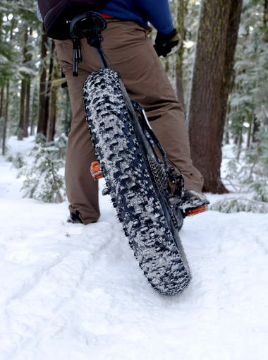 Fat bikes are able to ride on the snow due to unique wide tires that can range from 3.5 to 4.5 inches wide.