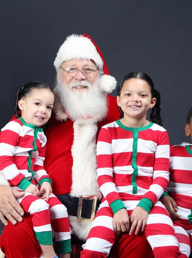 Bryce Williams, Adelena Rodriguez and Lilianna Rodriguez during a Santa photo shoot at The Arizona Republic in Phoenix on Sunday, Nov. 22, 2015.