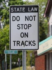 A sign at the Lake Road CSX railroad crossing in Congers. Cars have been hit by trains at the crossing.
