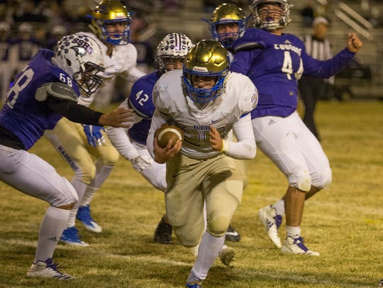 Reed's Josiah Schmidt runs for a touchdown in the second