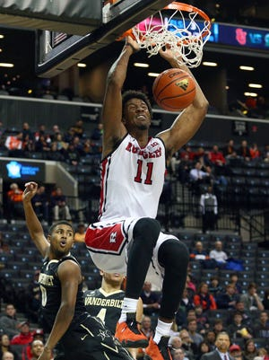 Rutgers forward Kadeem Jack  scores two of his 20 points with a two-handed slam.