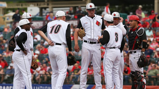 U of L coach Dan McDonnell approaches the mound after Kade McClure (19) allowed some base runs against FSU at Slugger Field during the ACC Tournament. 