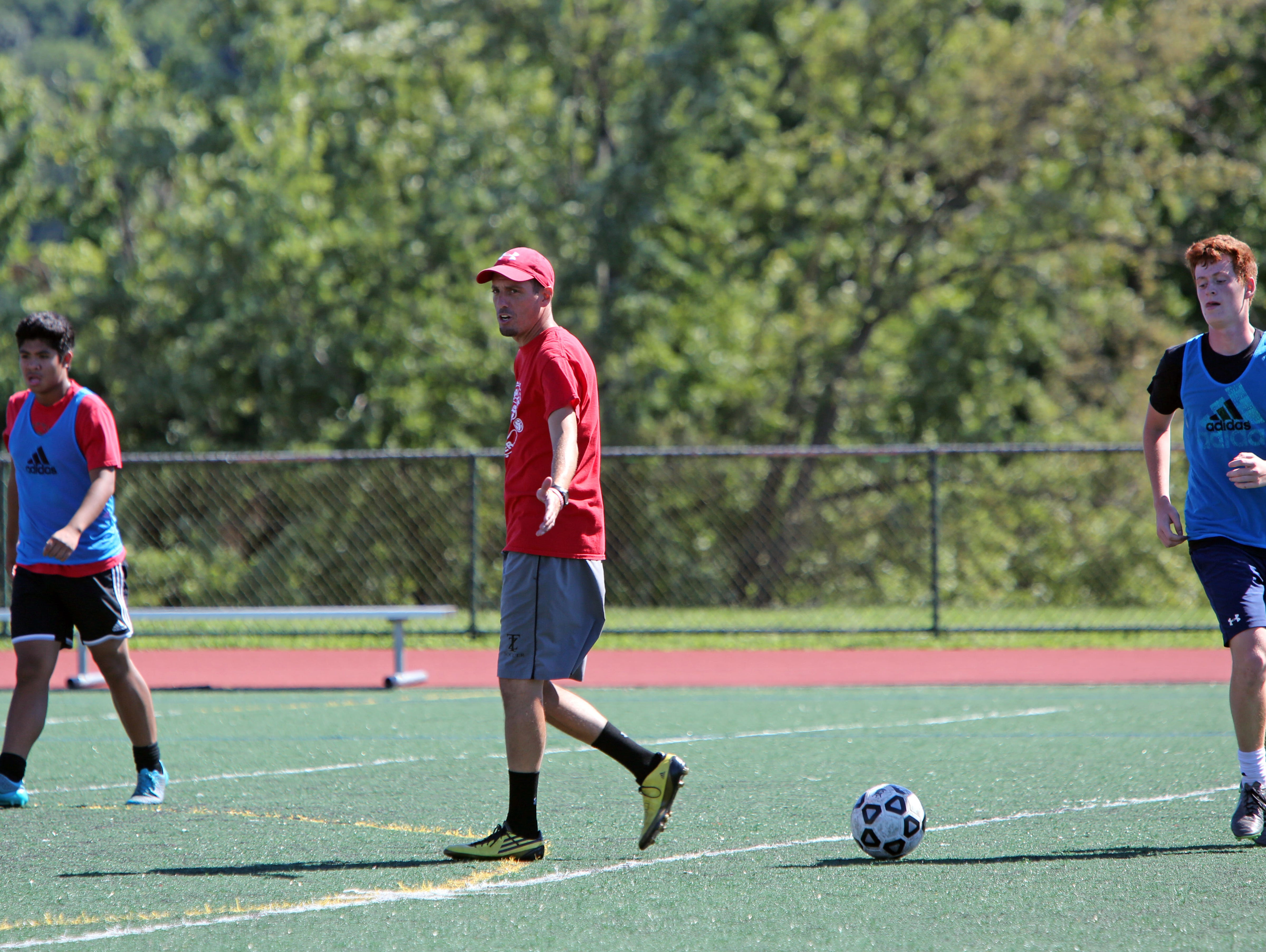 Coach Job Jacobs leads the first day of soccer practice at Tappan Zee High School Aug. 22, 2016.