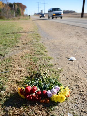 Flowers mark the scene of a crash that killed three teens on Wisconsin 22, north of Friendship Road in the town of Belle Plaine,  in October 2014.
