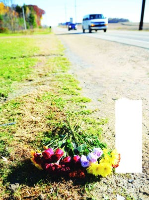 Flowers mark the scene of a crash that killed three teens on Wisconsin 22 south of Shawano in October 2014.