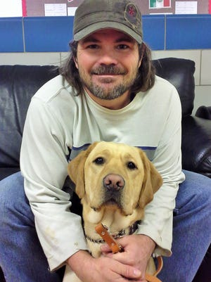 This grin on Todd Bevans' face tells the story. The legally blind North Liberty man who lost his service dog to cancer earlier this year was paired with his new dog, Murphy, last week while training at the Leader Dog for the Blind center in Michigan.