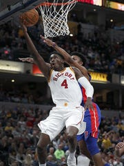 Indiana Pacers guard Victor Oladipo (4) puts up a shot as he is fouled by Detroit Pistons forward Stanley Johnson (7) in the second half of their game at Bankers Life Fieldhouse, Friday, Nov 17, 2017. The Indiana Pacers defeated the Detroit Pistons 107-100.