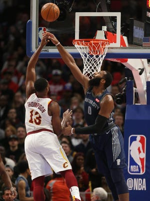 Andre Drummond blocks a shot by Cavaliers center Tristan Thompson during the first quarter Tuesday.