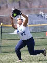 John Jay left fielder Nina Simms (97) pulls in a fly ball during their 3-0 win over Yorktown a varsity softball action at John Jay High School in Hopewell Junction on Tuesday, April 11, 2017.