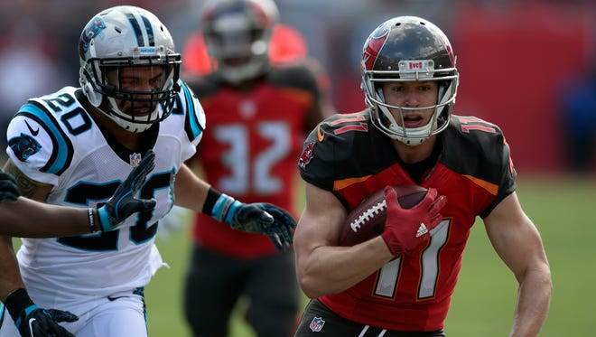 Tampa Bay Buccaneers wide receiver Adam Humphries (11) runs away from Carolina Panthers strong safety Kurt Coleman (20) after a reception.