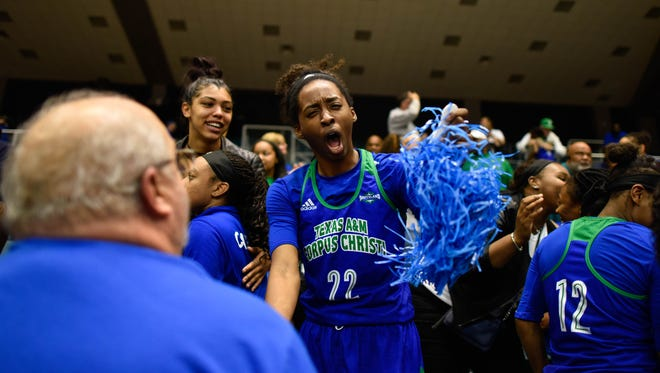 Texas A&M-Corpus Christi's Ashanti Plummer celebrates with fans after the Islanders topped New Orleans during the Southland Conference tournament on March, 10, 2017 at the Leonard E. Merrell Center in Katy.