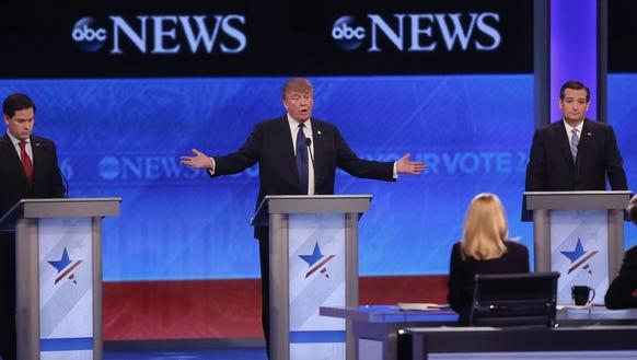 Donald Trump speaks alongside Marco Rubio and Ted Cruz