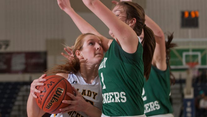St John Vianney's Kellyt Campbell drives into New Providence's Katie Kinum as she heads for the basket. St John Vianney vs New Providence in TOC First Round play on March 17, 2015 in Toms River. Peter Ackerman/Staff Photographer