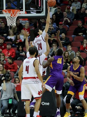 Louisville's Anas Mahmoud with one of his nine blocks against Albany.