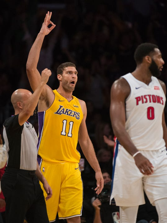 Los Angeles Lakers center Brook Lopez celebrates his three-pointer as Detroit Pistons center Andre Drummond looks away during the first half of an NBA basketball Tuesday, Oct. 31, 2017, in Los Angeles. (AP Photo/Kyusung Gong)