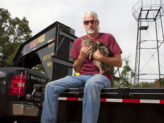 "Roy Garber and his feline companion on A&E's ""Shipping Wars."""