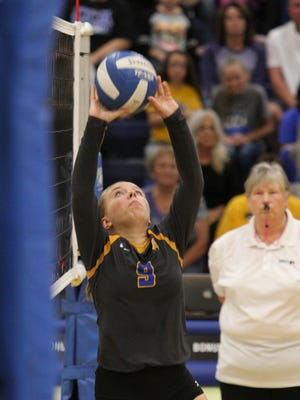 Benton's Jennifer McKinney sets the ball in volleyball action against Clear Creek Amana.