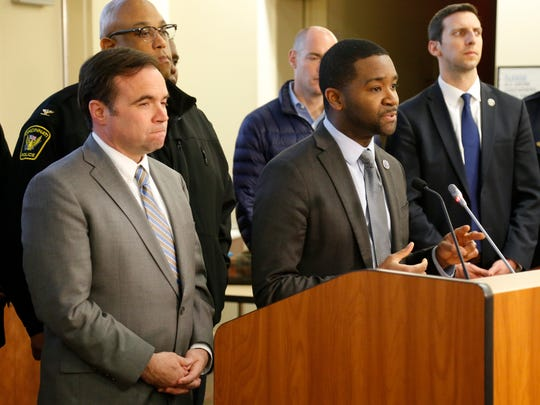Cincinnati Mayor John Cranley stands by as Acting City Manager Patrick Duhaney speaks about upcoming changes to the city's 911 services and the working conditions of those in the call center at the Hamilton County Emergency Communications Center in the East Price Hill neighborhood of Cincinnati on Monday, April 23, 2018.