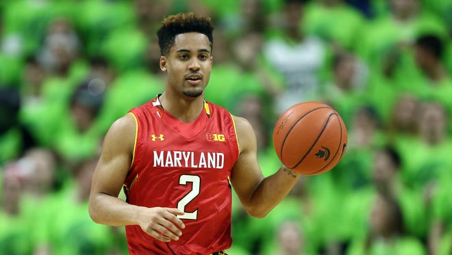 Maryland Terrapins guard Melo Trimble (2) dribbles the ball during the first half against the Michigan State Spartans at Jack Breslin Student Events Center.