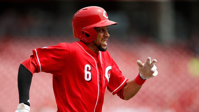 Cincinnati Reds center fielder Billy Hamilton (6) sprints to first base on a groundball during the MLB game between the Colorado Rockies and the Cincinnati Reds, Wednesday, April 20, 2016, at Great American Ball Park in Cincinnati.