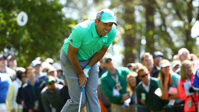 Sergio Garcia reacts after hitting his tee shot on the 4th hole during the first round of the Masters golf tournament at Augusta National Golf Club.