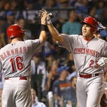 Chicago Cubs pinch hitter Adam Duvall, right, is greeted at home by Tucker Barnhart, after the pair scored on Duvall's home run off Chicago Cubs relief pitcher Justin Grimm, during the sixth inning of a baseball game Monday, Aug. 31, 2015, in Chicago. (AP Photo/Charles Rex Arbogast)