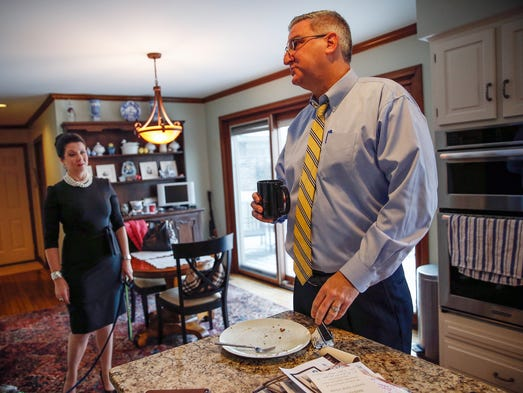 At his home in Indianapolis, Gov. Eric Holcomb finishes
