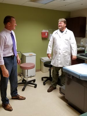 Randy Perkins discusses health care with Joseph Holbrook, ARNP.