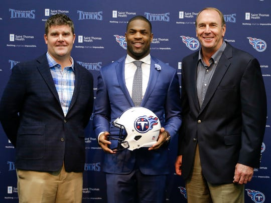 Tennessee Titans running back DeMarco Murray, center, poses with general manager Jon Robinson, left, and head coach Mike Mularkey, right, at a news conference Thursday, March 10, 2016, in Nashville, Tenn.