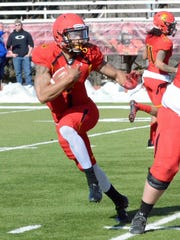 Jayru Campbell rushes during the team's spring game Friday.