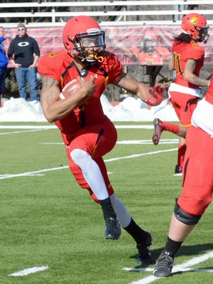 Ferris State quarterback Jayru Campbell rushes during the team's annual spring game Friday, April 20, at Top Taggart Field in Big Rapids.