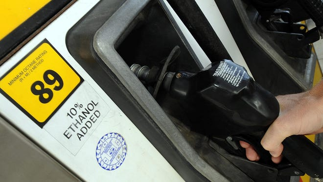 Ryan Smith, Jacksonville, Florida, fills his parents' car with gasoline containing 10 percent ethanol Tuesday afternoon.