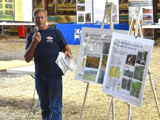 Beaver Dam producer Marty Weiss shares information on how he interseeds cover crops into 12 inch corn during last year's Healthy Soil, Healthy Water workshop.