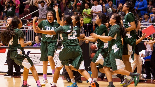 Tuba City celebrates after winning a Division III semifinal game against Safford at Gila River Arena in Glendale, Friday Feb. 27, 2015.