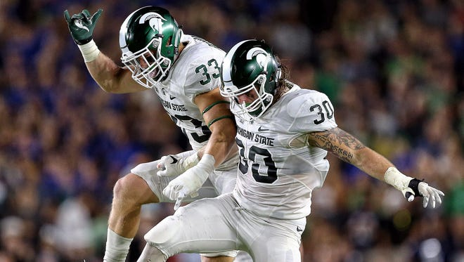Michigan State will play BYU on Saturday without linebackers Jon Reschke (33) and Riley Bullough.
