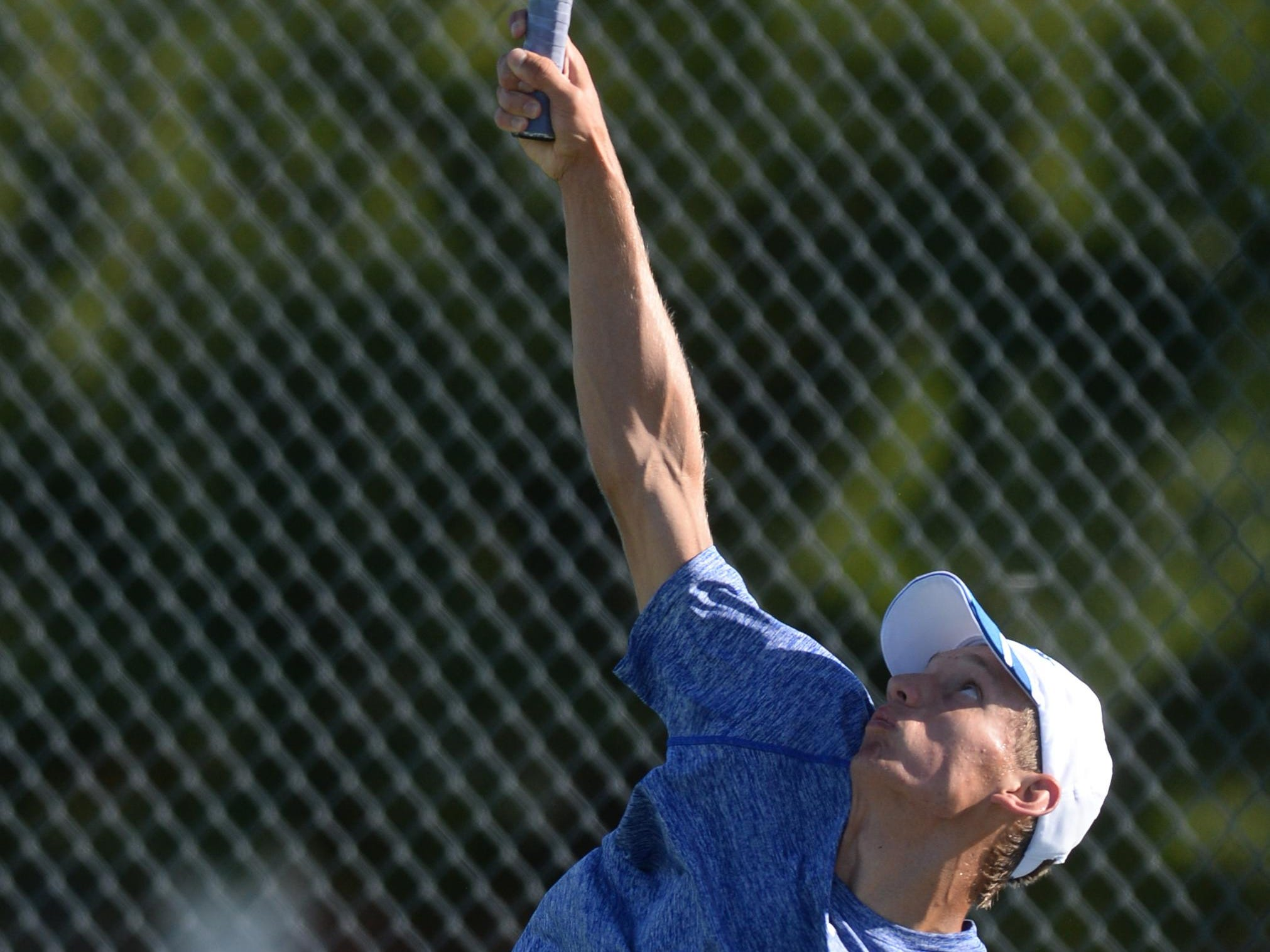 Centerville's Craig Lair serves the ball while playing No. 1 singles against Northeastern Wednesday at Fountain City.