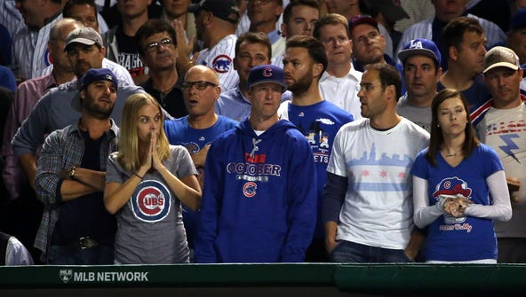 Chicago Cubs fans react during game four of the 2015