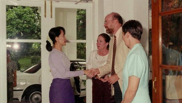 Ron and Jane McMullen meet Aung San Suu Kyi in 2002.