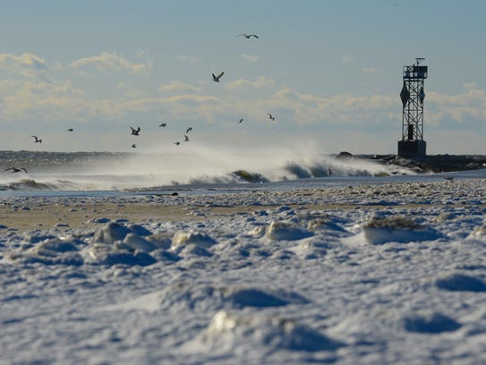 The Ocean City Inlet covered with snow and ice on Friday,