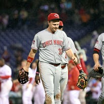 Reds right fielder Jay Bruce (32) and first baseman Joey Votto (19) walk off the field after Tuesday's loss to the Philadelphia Phillies at Citizens Bank Park.