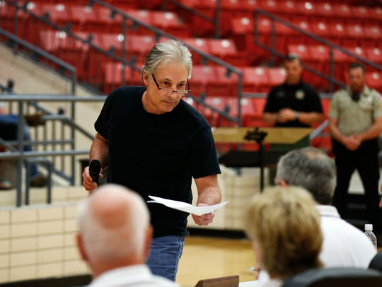 Reeds Spring resident Rick Stebbins delivers a petition,
