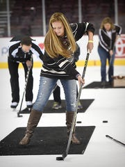 Shaefferstown resident Lindsey Fouch pactices on ice passing with Hershey Bears while attending the Hockey in Heels event earlier this week. The Hershey Bears Hockey Team held the 3rd Annual Hockey & Heels event  at the Giant Center on Thursday,  Jan. 15, hosting approximately 200 women who wanted to learn more about the game. Participants had the opportunity to practice on ice passing, shooting, locker room tours, an alumni session, and dinner with drinks.