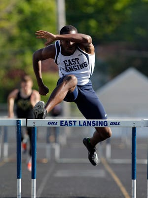 East Lansing's Kentre Patterson runs the 300-meter hurdles during a CAAC Blue track meet Friday, May 12, 2017, in East Lansing, Mich.